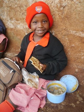 Kenyan girl eating lunch (1)